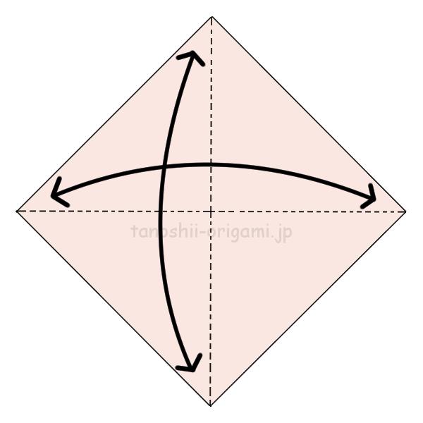 折り紙を三角に折る