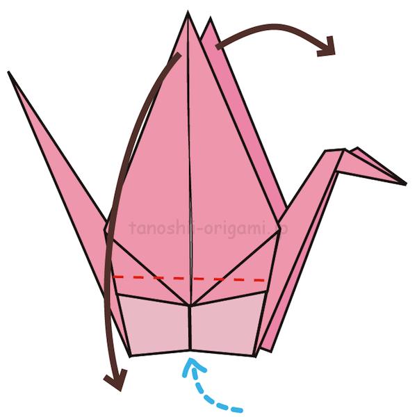 19.下から息を吹きながら羽を左右に広げる