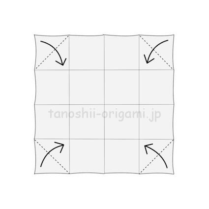 1.折り紙に折り線をつけて、角を三角に折る。