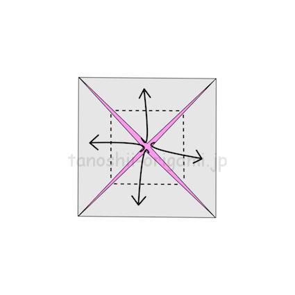 6.折り線に合わせて角を真ん中から外側に折る (2)
