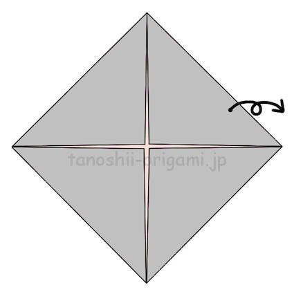 1.折り紙の4つの角を真ん中に向けて折り、開く