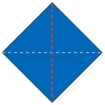 2.折り紙の白い面が表にくるように三角に折る。